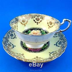 Gold Swag on Pale Yellow with Chrysanthemums on Black Paragon Tea Cup & Saucer