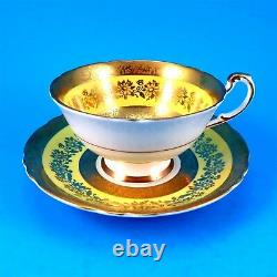 Heavy Gold Rose Center with Yolk Yellow Border Paragon Tea Cup and Saucer Set