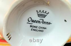 Queen Anne Heavy Gold With Floating Red And White Roses Tea Cup And Saucer Set